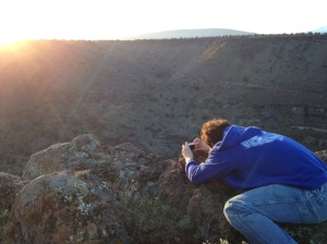 Crouching to capture the sunset.